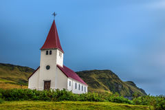 Heavy clouds over the lutheran church in Vik, Iceland Stock Photos