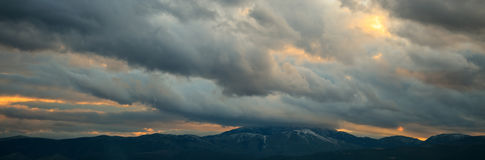 Heavy clouds over mountains Stock Image