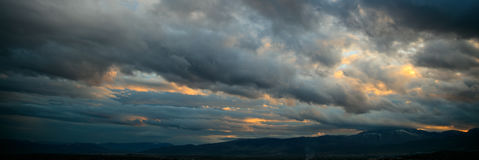 Heavy clouds over mountains Royalty Free Stock Photo