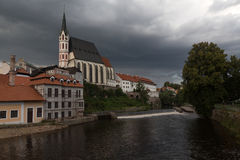Heavy clouds over the red roofs af czehien town Cheski-Krumlov Royalty Free Stock Image