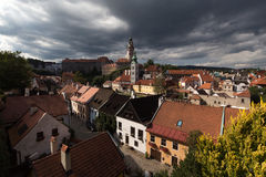 Heavy clouds over the red roofs at czehien town Cheski-Krumlov Royalty Free Stock Photo