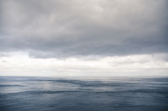 Heavy clouds over the sea Stock Photography