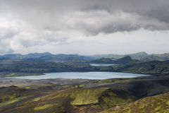 Heavy clouds over still lakes and mossy hills in Lakagigar, Icel Royalty Free Stock Image
