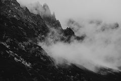 Heavy clouds on the sharp Tatra mountain, black and white with n Royalty Free Stock Photography