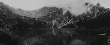 Heavy clouds on the sharp Tatra mountain, black and white with n Stock Image