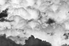 Heavy clouds sky monochrome texture. Black and white texture with some heavy clouds on the sky stock images