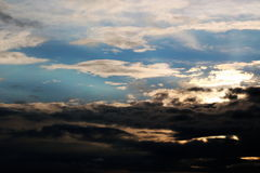 Heavy clouds at sunset Stock Photography
