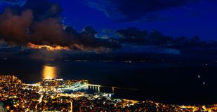Panoramic view of the city. Heavy cloudscape over city of Kavala, Greece stock photos