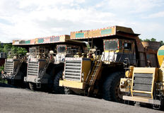 Heavy coal dumpers in a opencast mine Stock Photography