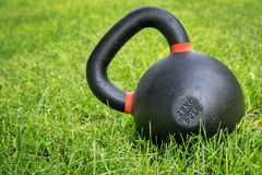 Heavy competition  kettlebell in backyard Royalty Free Stock Photo