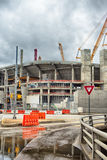 Heavy construction cranes erecting concrete building. Heavy  construction cranes erecting concrete building Royalty Free Stock Image