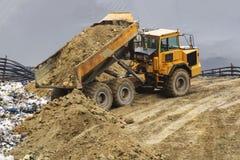 Heavy construction dumper at work. In a landfill, dumper, dump, lorry, mining, wasteland, waste stock photos