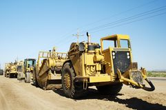 Heavy Construction Equipment. Heavy equipment at a residential construction site Stock Photo