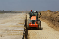 Heavy construction equipment compacting soil on a runway construction site. TULCEA, ROMANIA - SEPTEMBER 26: Heavy construction equipment compacting soil on a Stock Images