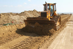 Heavy construction equipment working on a runway construction site Stock Photos