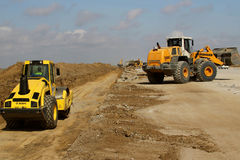 Heavy construction equipment working on a runway construction site Stock Image