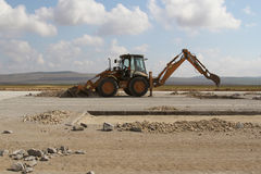 Heavy construction equipment working on a runway construction site. TULCEA, ROMANIA - NOVEMBER 08: Heavy construction equipment working on a runway construction Stock Images