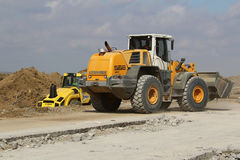 Heavy construction equipment working on a runway construction site Stock Photo