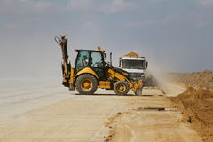 Heavy construction equipment working on a runway construction site. TULCEA, ROMANIA - NOVEMBER 08: Heavy construction equipment working on a runway construction Stock Image