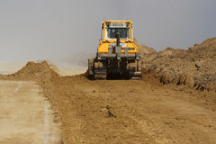 Heavy construction equipment working on a runway construction site. TULCEA, ROMANIA - NOVEMBER 08: Heavy construction equipment working on a runway construction Royalty Free Stock Photography