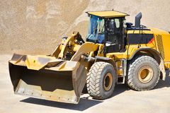 Heavy construction machine in open-cast mining - wheel loader tr royalty free stock image