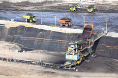 Heavy construction tipper trucks dump coal Stock Photo