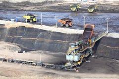 Heavy construction tipper trucks dump coal Stock Photo