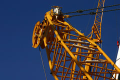 Heavy crane. Fragment of a yellow heavy duty crane Stock Photos