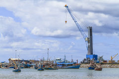 Heavy crane with fishing boat Royalty Free Stock Image
