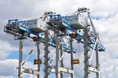 Heavy cranes against cloudy sky Stock Photo
