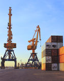 Heavy cranes and containers Royalty Free Stock Images