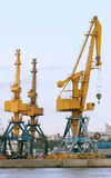 Heavy cranes in the harbor Royalty Free Stock Photography