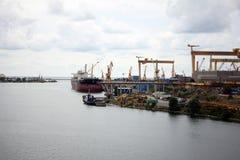Heavy cranes in the port Stock Image