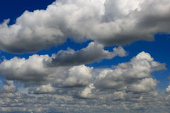 Heavy cumulus clouds, but white. Royalty Free Stock Photography