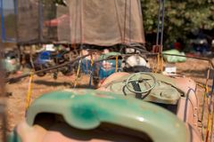 Heavy damaged toy car of roller coaster. In Amusement park in Banlung town. Cambodia. march 2018 stock image