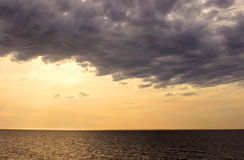 Heavy dark cloud above sea Stock Photo