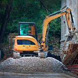 Heavy digger machine vehicle working at place Stock Images