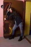 Heavy door in underground shelter. Woman posing on heavy door in underground shelter Royalty Free Stock Photo