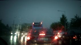 Heavy downpour from car. Interior with wipers stock footage