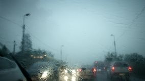 Heavy downpour from car. Interior with wipers stock video