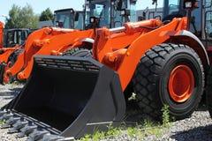 Heavy dozer. New, shiny and modern orange dozer machine. Construction industry machinery royalty free stock images