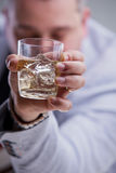 Heavy drinker shows a glass of blame. Heavy drinker shows a glass of white wine on the rocks stock images
