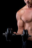 Heavy dumbbells in the hands of a Muscled Royalty Free Stock Image