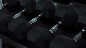 Heavy dumbbells in sports gym.  stock video