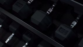 Heavy dumbbells in sports gym.  stock video footage