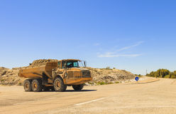 Heavy dump truck or dumper. On the road royalty free stock photo
