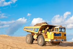 Heavy dump truck with soil in a body. Heavy dump truck with sand or soil in a body at a construction site royalty free stock photos