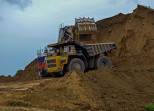 Heavy dump truck at work. Dump truck at work in a mine royalty free stock image