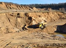Heavy dump truck working in a sand pit. Image stock photo