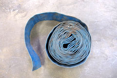 Heavy duty blue hose on the ground. Royalty Free Stock Images